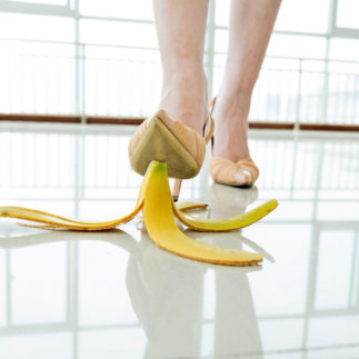 The Directress stepping on banana skin