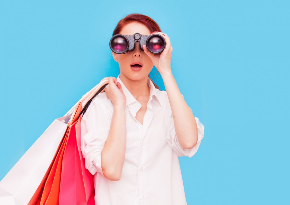 woman with shopping bags and binocular