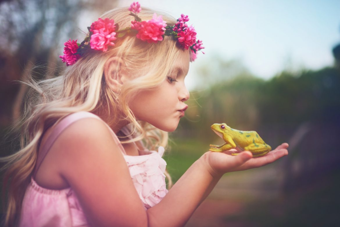 little girl holding a frog