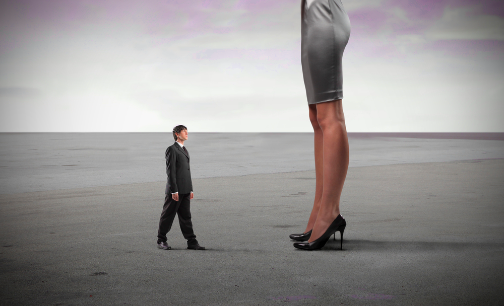 Patriarchy: A tall woman looking down at a small man
